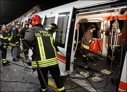 Firefighters inspect a carriage of a metro train at Rome's Piazza Vittorio Emanuele II station