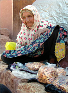 Old woman selling goods. Photograph by Hamed Behnam