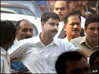 Santosh Kumar Singh is led away by police after the verdict