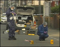 Police at the scene of the crime in Luton