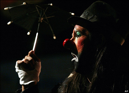 A clown with an umbrella