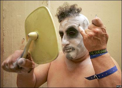 A clown puts on make-up