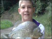 Josh Boyle holding the piranha