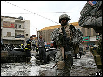 US patrol inspect aftermath of a bombing in Baghdad