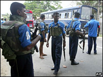 Sri Lankan Navy soldiers man a checkpoint outside the naval base in Galle after the rebel attack
