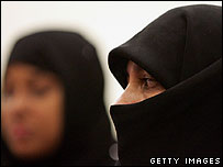 A British Muslim woman wearing niqab veil and another woman wearing a hijab