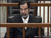 Saddam Hussein at his trial on 18 October