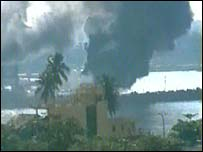 Smoke rises from Galle harbour after the attack (photo from Defence ministry)