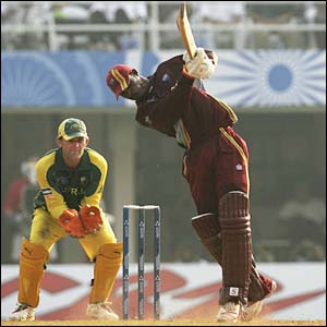Runako Morton hits out, watched by Adam Gilchrist