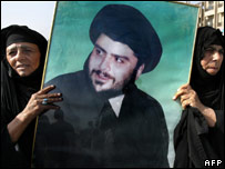 Shia women carry poster of Mr al-Sadr on protest against detention of Sheikh Mazin al-Saedi