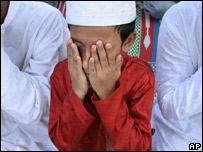 Boy praying during Ramadan