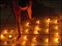 Candles being lit for Diwali