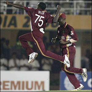 Jerome Taylor celebrates the wicket of Ricky Ponting