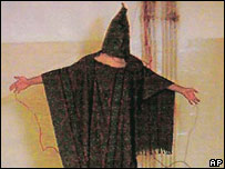 Hooded detainee in Abu Ghraib prison