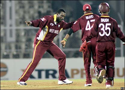 Chris Gayle celebrates bowling Andrew Symonds