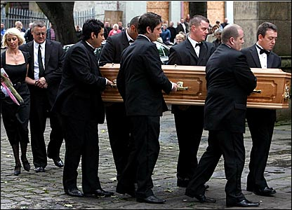 Matthew Stevens (centre) helps carry the coffin into church