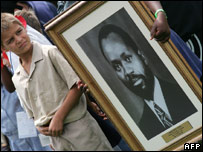 Children with portrait of Samora Machel