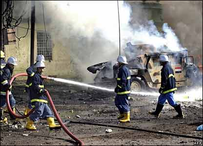 Iraqi firefighters at the scene of the attack in Kirkuk
