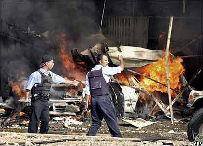 Iraqi police at the site of a car blast in Kirkuk, northern Iraq