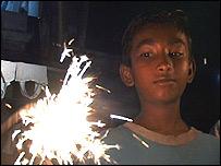 Raju, 8, with sparkler