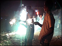 Children playing with Diwali sparklers