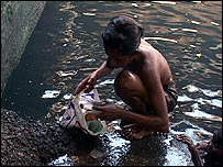 Armaan scavenging for bottles in Mumbai's canals