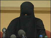 Aishah Azmi speaking at a press conference