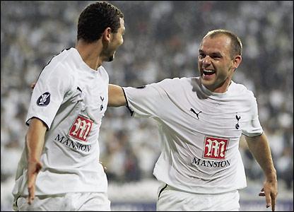 Hossam Ghaly celebrates with Danny Murphy