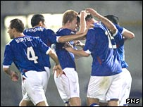 Penalty goalscorer Kris Boyd is congratulated by his team mates