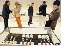 Potential bidders leaf through the wine list in Paris