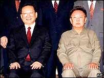 Tang Jiaxuan (left) and Kim Jong-il (right)