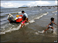 Mothers wash clothes and children play on the shores of Lake Nicaragua, also known as Cocibolca