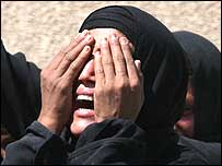 An Iraqi woman mourns the loss of a relative