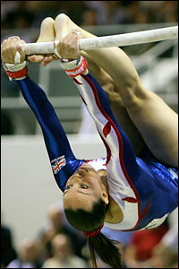 Beth Tweddle of Great Britain performs on the uneven bars