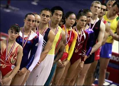 Medal-winning gymnasts line-up at the medal ceremony in men's and women's apparatus finals