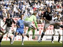 Richard Dunne heads past his own keeper