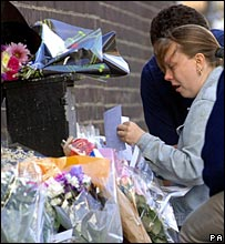 Family members look at tributes