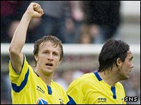 Gary Wales celebrates with fellow scorer Danny Invincibile