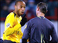 Thierry Henry argues with the referee
