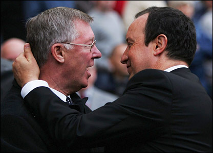 Sir Alex Ferguson and Rafael Benitez happily embrace