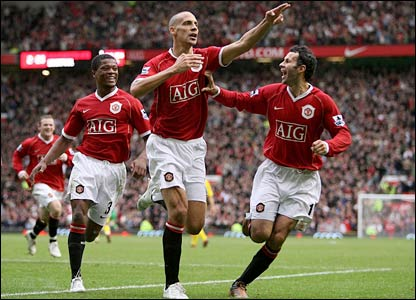 Rio Ferdinand (centre) celebrates his goal