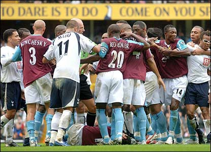 Tottenham Hotspur and West Ham United players confront each other after Jermain Defoe's foul