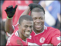 Yakubu celebrates with George Boateng