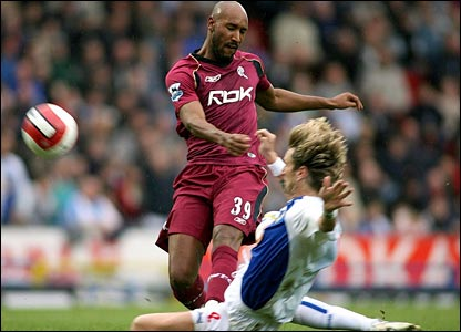 Bolton Wanderers' Nicolas Anelka (left) and Blackburn Rovers' Robbie Savage tussle