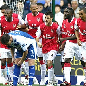 Arsenal's Thierry Henry celebrates scoring with team-mates