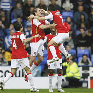 Alex Hleb of Arsenal is congratulated by team-mate Tomas Rosicky