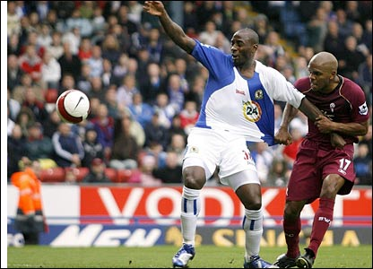 Blackburn Rovers' Jason Roberts (left) has his shirt pulled by Bolton Wanderers' Quinton Fortune