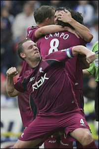 Kevin Nolan of Bolton Wanderers joins in the celebrations as Ivan Campo (8) celebrates his winning goal