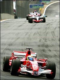 Felipe Massa ahead of Kimi Raikkonen and Jarno Trulli early in the Brazilian Grand Prix
