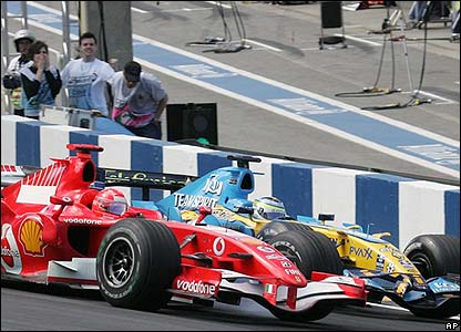 Schumacher attempts to overtake Giancarlo Fisichella